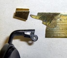 Broken hinge and brass shim stock repair parts