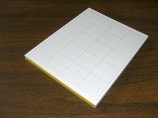 Quarter-sheet grid tablet - showing binding