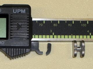 Broken caliper thumb roller mount