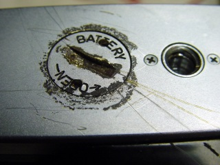 Corroded battery lid with scarred camera base