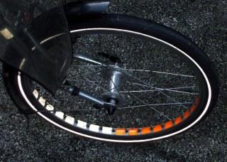 Bike wheel with retroreflective tape