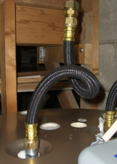 Flexible tube heat trap loop