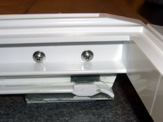 Refrigerator shelf bracket - inside