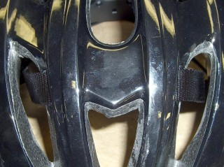 Front strap passing through helmet