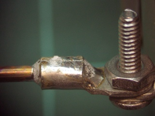 Crimped and soldered lug