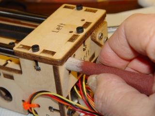 Adjusting rod hole position