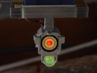Reflected spot near laser aperture