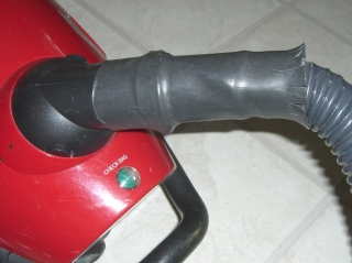 Strain relief on vacuum hose
