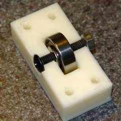Idler housing with recessed bolt