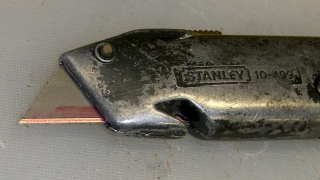 Utility cutter with marked blade
