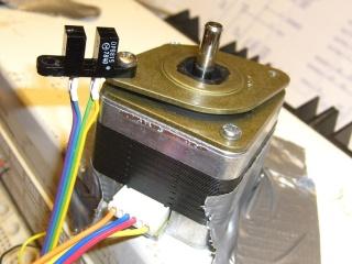 Optical interrupter on stepper isolator bushing
