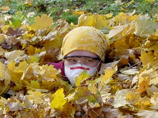 Shop Assistant in Autumn leaf pile