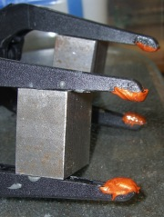 Clamps with copper-silicone gasket pads