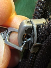 Worn-through zipper tab