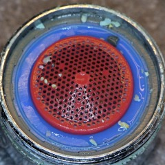 Bath faucet nozzle grit