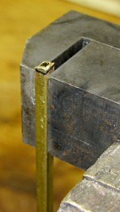 Shaping case latch bar