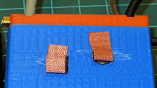 Copper mesh on GPS case contacts