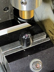 Laser aligning to knob feature