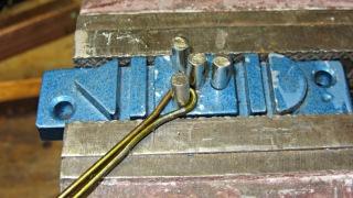 Screwdriver clip - screw bend