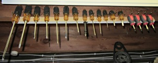 Screwdriver rack on floor joist