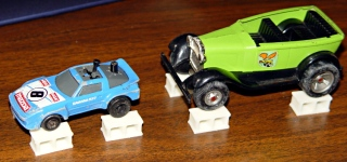 Toy cars up on blocks