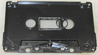 Cassette tape case - detached bushing