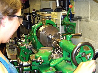Karen at the lathe