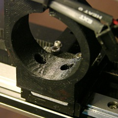 M2 extruder - motor mount clamp - plastic ripples