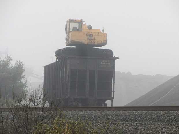 Excavator on CSX gondola car - end