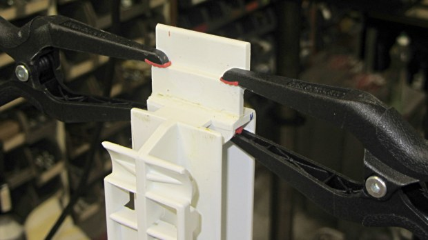 Refrigerator strut - tab clamps