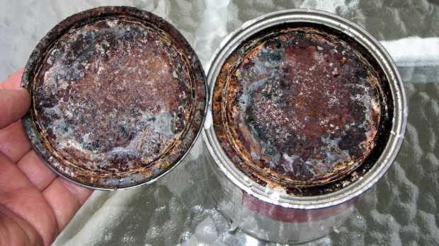 Paint can stored upside-down - interior