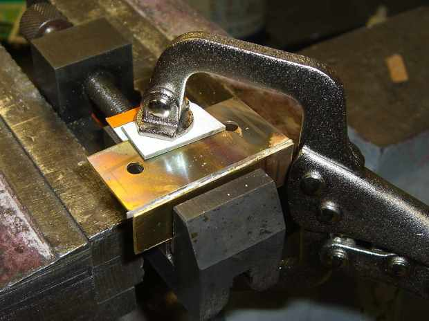Brass switch bracket - clamped for soldering