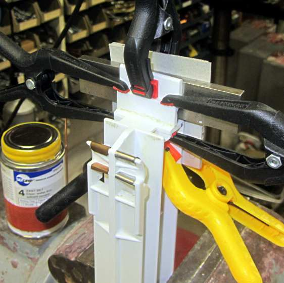 Whirlpool refrigerator drawer strut - clamped
