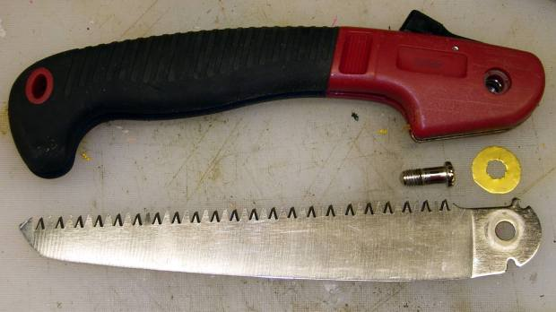 Folding saw - pivot shim