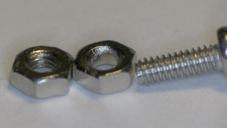 Unthreaded 2 mm nut
