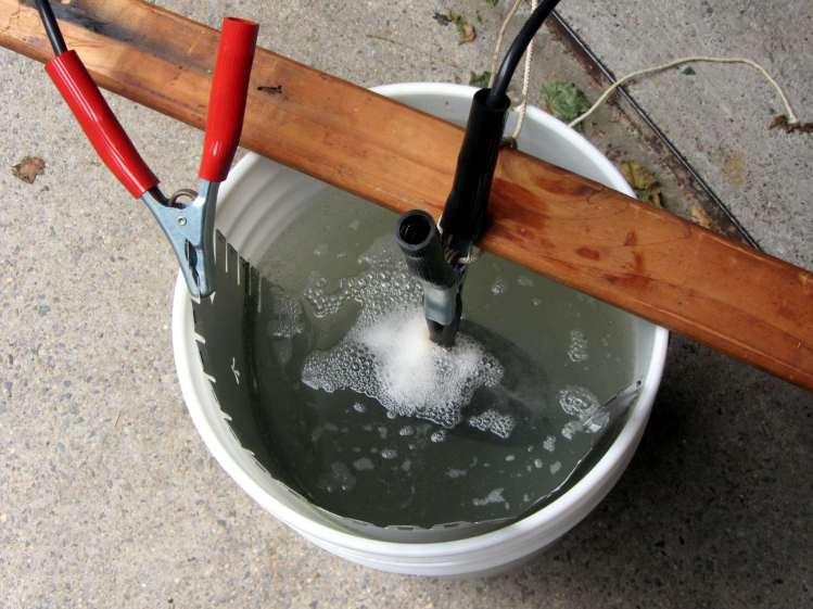 Cast iron pan electrolysis - bucket