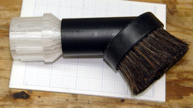 Dust brush adapter - reinforced tube - installed