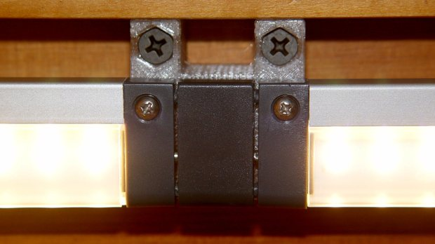 Under-cabinet light bracket - center joiner