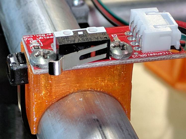X min endstop - recessed cable tie latch