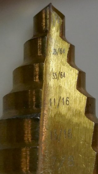 Quasi-inch step drill