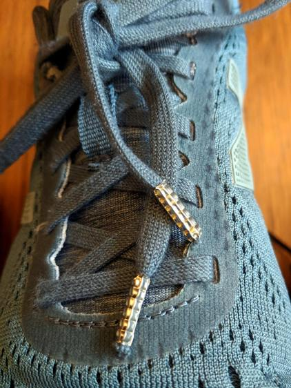 Shoelaces with crimped ferrules