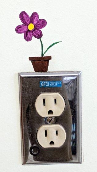 Outlet flower