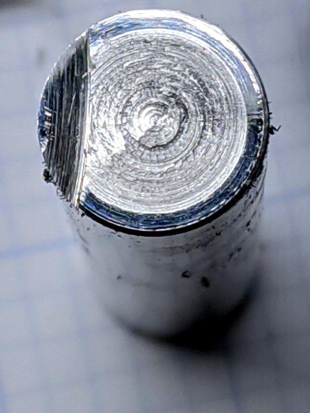 Hardened shaft facing - abrasive step