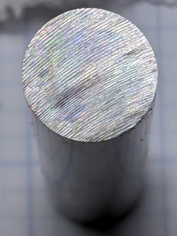 Hardened shaft facing - abrasive flattening