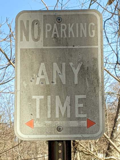 Faded NO PARKiNG sign