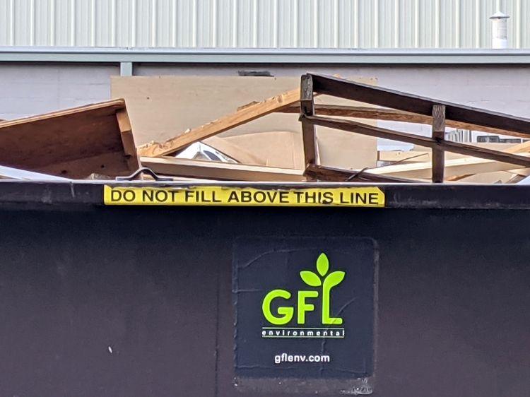Overloaded dumpster - detail