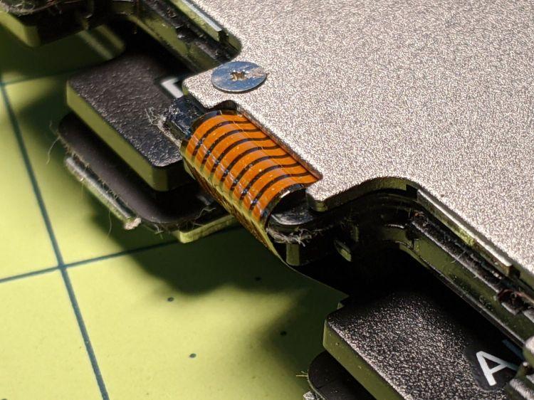 Folding keyboard - acute cable fold edge